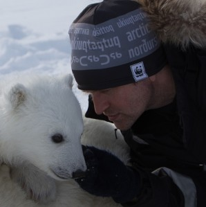 Figure 1. Biologist Jon Aars with a Svalbard cub.
